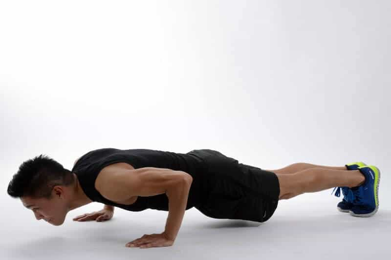 male personal trainer performs push-ups