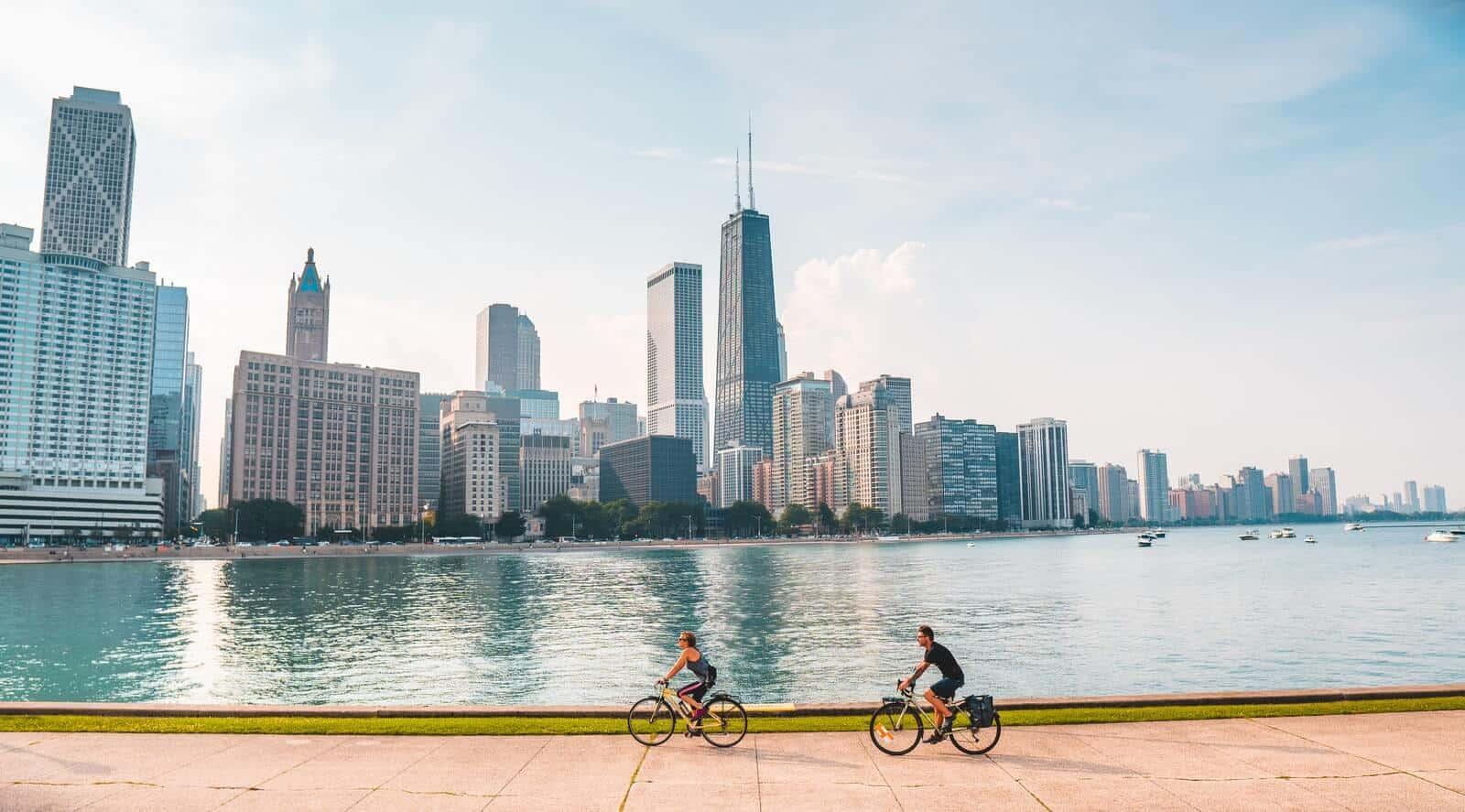 two people ride their bikes through Chicago