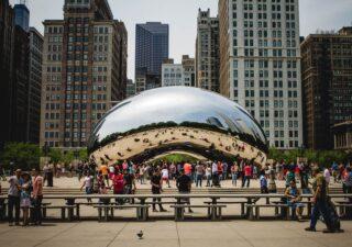 People walk around the Chicago Bean