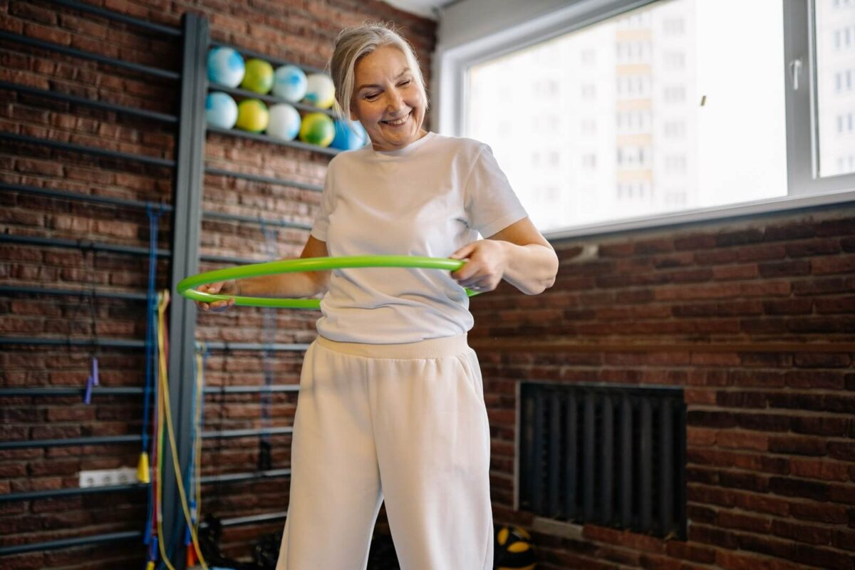 older-woman-exercises-with-hula-hoop-1200x800.jpg